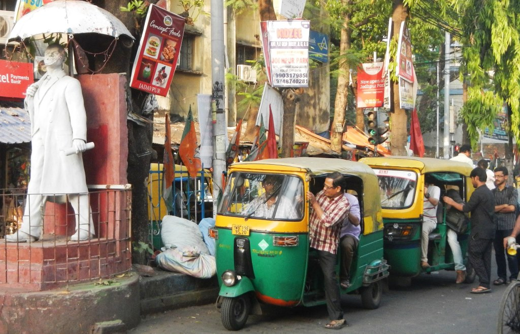 Auto rickshaws operating on the streets of Kolkata.